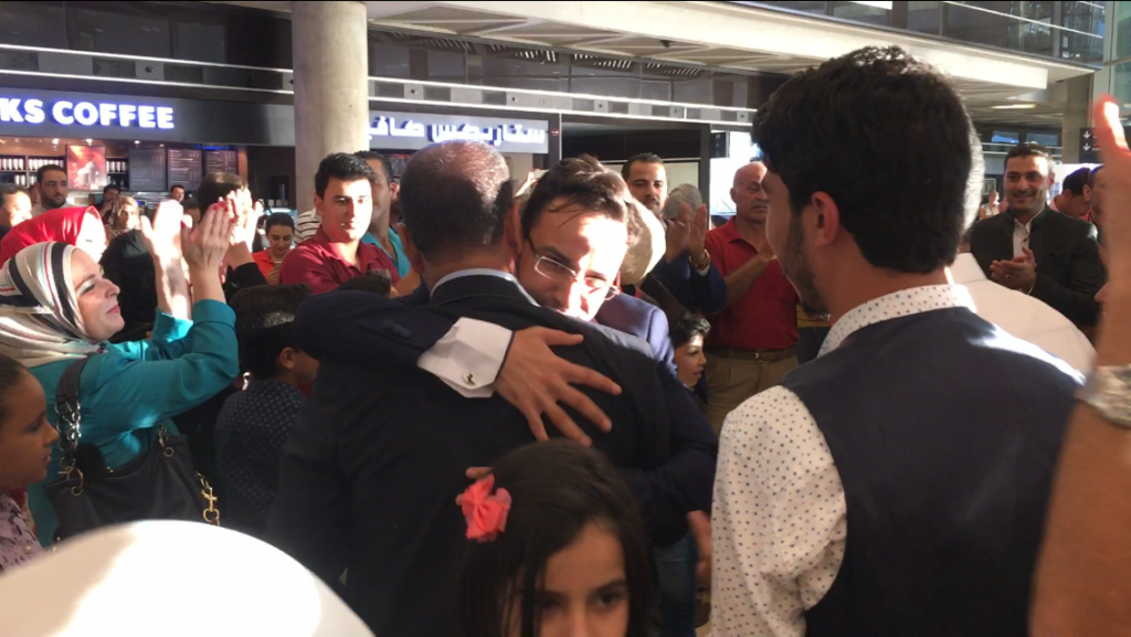 A family at the airport celebrates the return of one of their own.