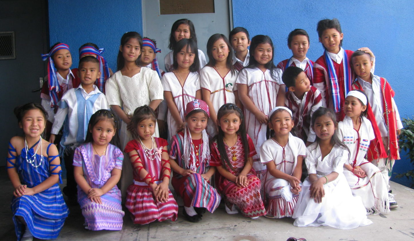 Children dressed in traditional clothes; many families are served by RefugeeNet, a local nonprofit that helps new Americans.