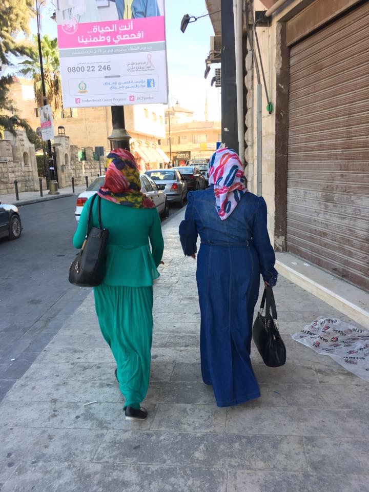 Muslim women walking down the street in Madaba.