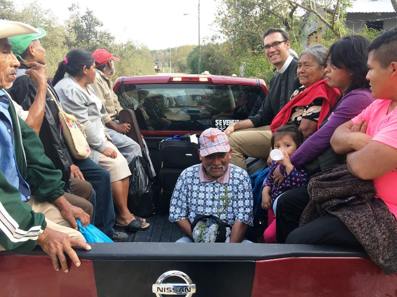 Transportation to the celebration of a new bishop means riding Pame-style in the back of a pickup truck.